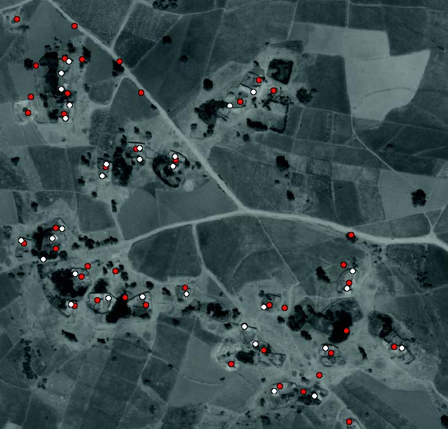Result from scanning our building detector over farmland in Koraro, Ethiopia where red points mark computer guesses and white points mark human guesses